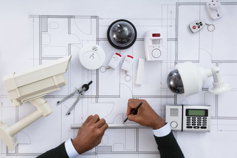 Architect working on a design with ruler and pencil - Business Protection Specialists
