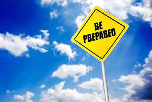 Blue sky with a yellow diamond sign that says be prepared - Business Protection Specialists