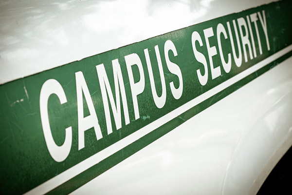 Close up of letters on a campus security vehicle that says Campus Security - Business Protection Specialists