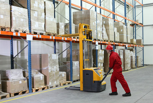 Factory worker working with a fork lift - Business Protection Specialists