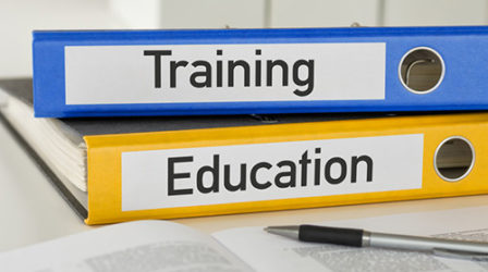 Two binders that say Training and Education - Business Protection Specialists