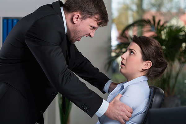 Angry Man Gripping And Yelling At A Scared Employee He Is Firing